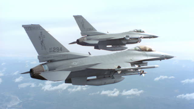 f-16 fighter jets fly through the sky. - g force stock videos & royalty-free footage