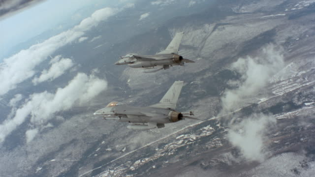 f-16 fighter jets fly through the sky. - fighter stock videos & royalty-free footage