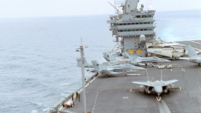 fighter jets line the deck of an aircraft carrier. - aircraft carrier stock videos & royalty-free footage