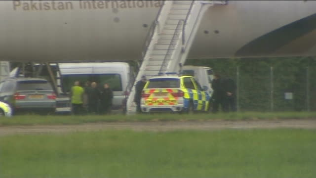 vídeos de stock, filmes e b-roll de fighter jets scrambled following incident on pia passenger aircraft two men arrested england essex stansted airport ext various shots of pia aircraft... - ovo mexido