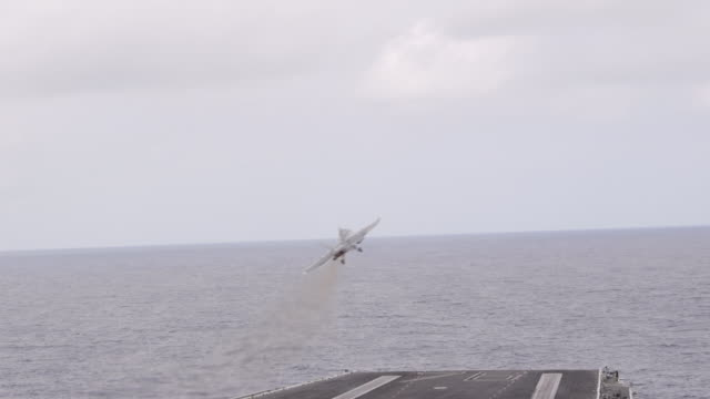 fighter jets take off from us navy aircraft carrier in pacific ocean, montage - aircraft carrier stock videos & royalty-free footage