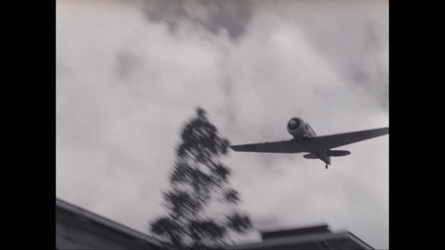 ms pan fighter plane flying over military building / united states - pearl harbor stock videos and b-roll footage
