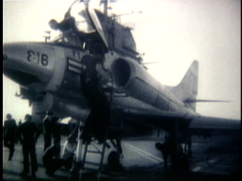 vídeos de stock, filmes e b-roll de us fighter plane on aircraft carrier deck and taking off around the time of the gulf of tonkin incident / north vietnam - 1964