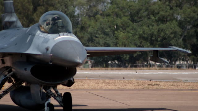 fighter plane on runway - aereo militare video stock e b–roll