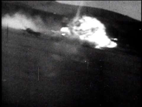 fighter planes diving / aerial bomb hitting the ground and exploding / pilot's head looking down through smoke / aerial rhine river with smoke rising... - 空爆点の映像素材/bロール