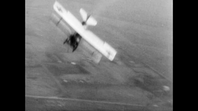 fighter planes in the sky / biplanes in dogfight chasing each other in the sky / biplane diving wwi fighter pilots on january 01 1915 in unspecified - 複葉機点の映像素材/bロール