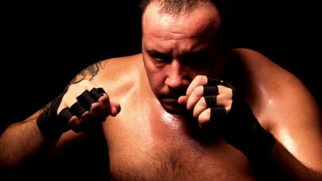 stockvideo's en b-roll-footage met fighter - worstelen