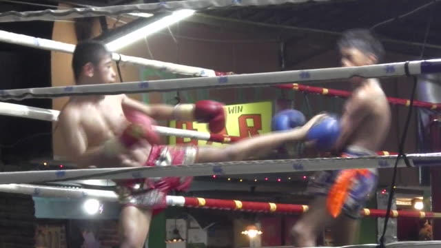 fighters compete in muay thai boxing at thaphae boxing stadium in chiang mai - thai ethnicity stock videos & royalty-free footage