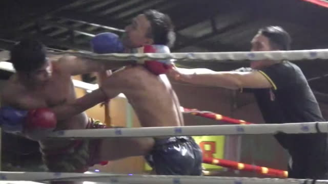 fighters compete in muay thai boxing at thaphae boxing stadium in chiang mai - muay thai stock videos and b-roll footage