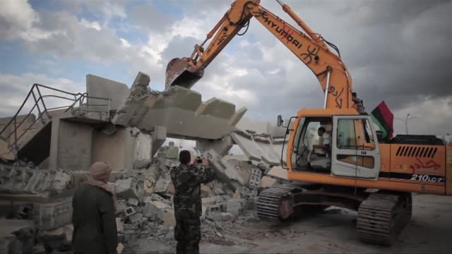 ntc fighters destroy the walls of former strongman moamer kadhafi's compound in the bab alazizya district in tripoli on sunday as young fighters... - former stock videos & royalty-free footage