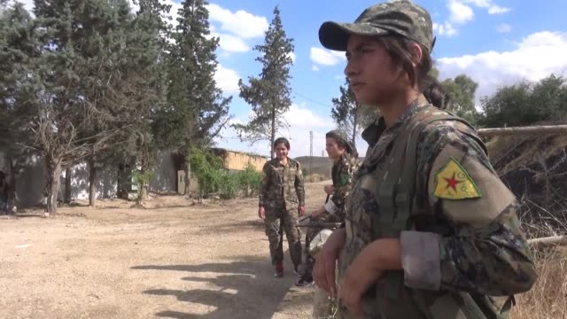 fighters from the kurdish people's protection units and kurdish female women's protection units train and prepare their weapons at a camp in the... - people's protection units stock videos & royalty-free footage