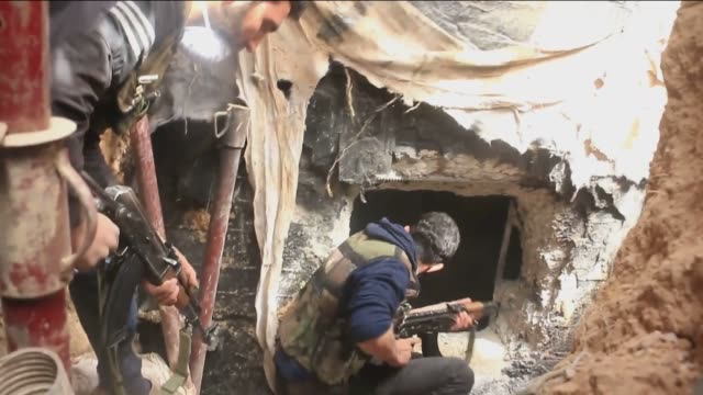fighters from the shuhada alislam brigades syrian opposition group linked to free syrian army have seized control of the tomb of sayyidah sakinah... - hezbollah stock videos & royalty-free footage