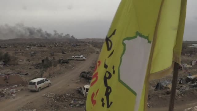 fighters from the syrian democratic forces are on the ground in baghouz amidst the debris from the battle against the islamic state group the day... - syrian democratic forces stock videos & royalty-free footage