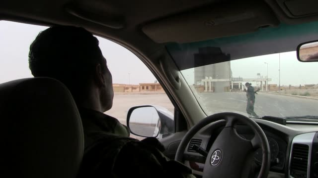 fighters of the kurdish people's protection units ypg sit in a car at the entrance to a military compound on october 13, 2014 in al hasakah or... - people's protection units stock videos & royalty-free footage