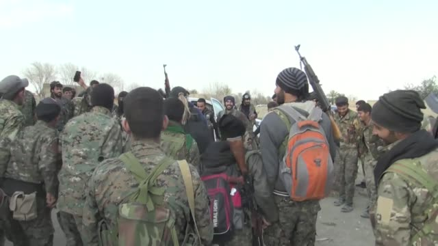 fighters of the syrian democratic forces dance and celebrate the imminent fall of baghouz the last islamic state group holdout - syrian democratic forces stock videos & royalty-free footage