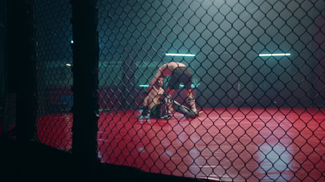 mma fighters throwing punches in octagon. knockout - octagon stock videos & royalty-free footage