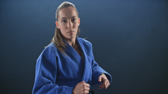 slo mo pov fighting a female judoist in blue outfit - world sports championship stock videos & royalty-free footage