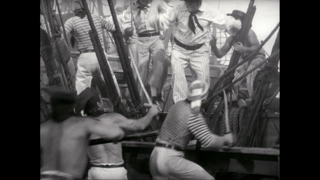 ms fighting between sailors and pirates on deck of ship / united states - seeräuber stock-videos und b-roll-filmmaterial