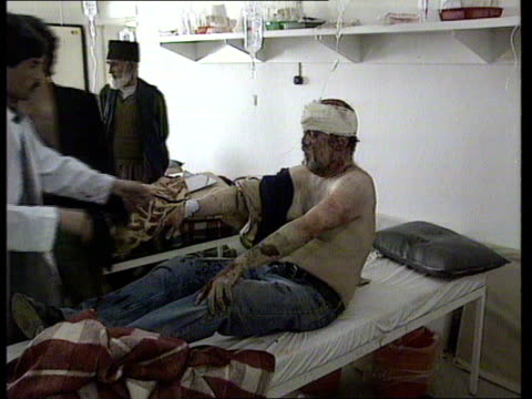 Kabul Gillian Biddolph intvwd SOF We are gettig gunshot wounds and shelling injuries INT MS Injured man on bed being attended to by doctor TMS...
