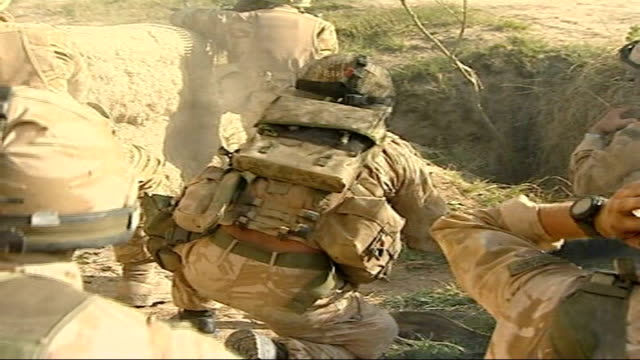 Fighting continues against Taliban / Eyewitness account of ambush Walls around compound British soldiers firing weapon SOT Marines running along to...