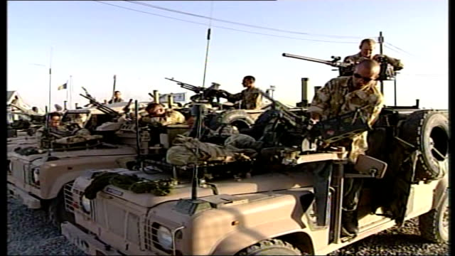 fighting continues as two killed soldiers are named afghanistan location unknown ext british soldier preparing weapon british troops on armoured... - attack helicopter stock videos and b-roll footage