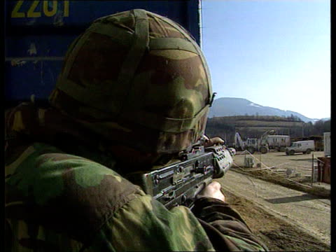 fighting continues bosnia gornji vakuf cbv british soldier looking around corner with rifle ms soldier with rifle - 1993 stock videos & royalty-free footage