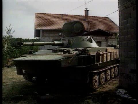fighting continues croata ms pt76 tank ms gun on roadside - bosnien und herzegowina stock-videos und b-roll-filmmaterial