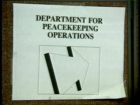 fighting continues itn lams poster on wall of office united nations peace keeping tilt down to woman working on typewriter lms women along hall in... - 1993 bildbanksvideor och videomaterial från bakom kulisserna