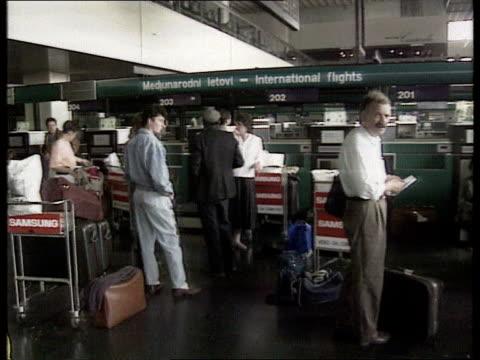 fighting continues/ serbia: demos/ sanctions; int yugoslavia serbia belgrade airport air passengers sitting in departure lounge l-r bv people... - serbia stock videos & royalty-free footage
