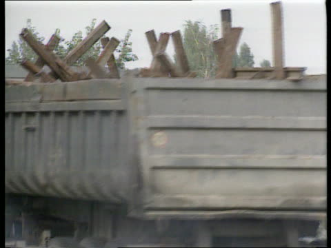 fighting continues yugoslavia zagreb bv people sitting on fence at roadblock outside army base as trucks containing dismantled roadblock parked in... - 旧ユーゴスラビア点の映像素材/bロール