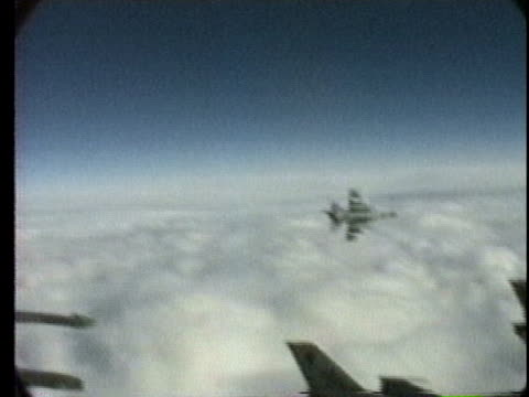 fighting falcons fly above the clouds over iraq during operation desert shield. - fighter stock videos & royalty-free footage