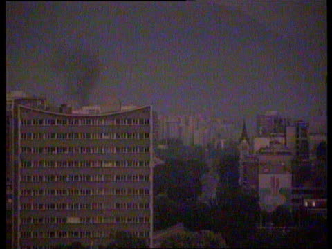 fighting in sarajevo/refugees/aid airlift bosniaherzegovina sarajevo gv skyline as tracer fire seen amp explosions heard sof gv ditto day gv roofs... - bosnia and hercegovina stock videos & royalty-free footage