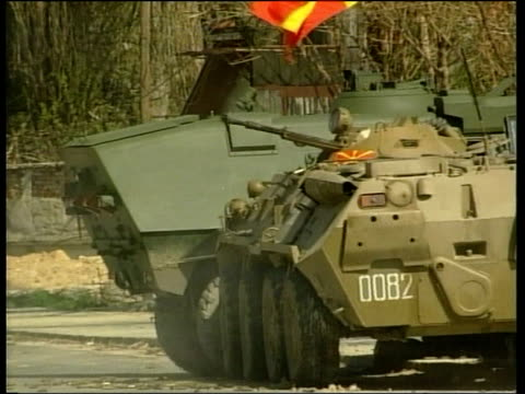 stockvideo's en b-roll-footage met fighting with albanian rebels escalates; fighting with albanian rebels escalates; itn macedonia: tetovo ext machine guns mounted on macedonian army... - omgeven
