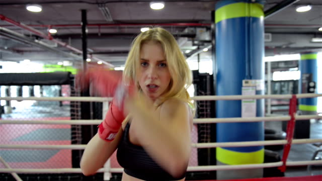Fighting woman shadow boxing