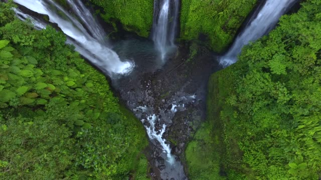 figi waterfalls in bali, indonesia - famous place stock videos & royalty-free footage