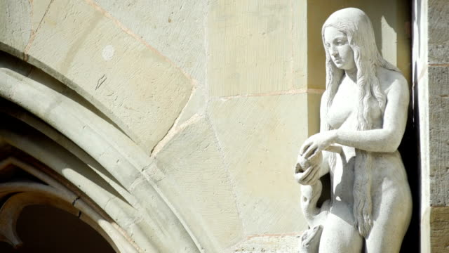 figure of eve in rothenburg tilt up (4k/uhd to hd) - christianity stock videos and b-roll footage