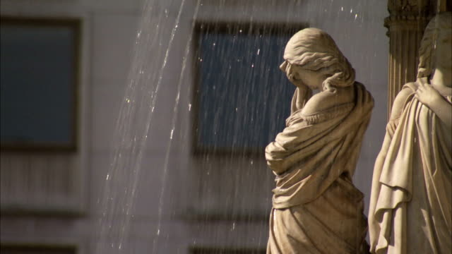 a figure representing sorrow stands on a fountain outside the vienna state opera house. available in hd. - femininity stock videos & royalty-free footage