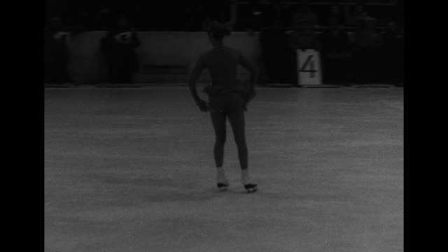 ms us figure skater carol heiss performing her routine on the ice at the winter olympics / ext bldgs in the village of garmischpartenkirchen west... - garmisch partenkirchen stock videos & royalty-free footage
