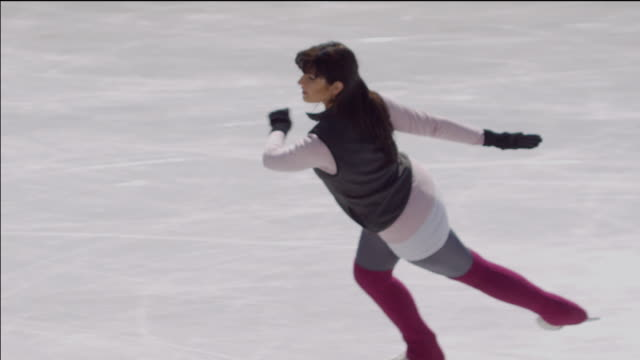 sm ha ms zo figure skater spinning on ice/ long island, ny - leg warmers stock videos & royalty-free footage