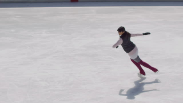 sm ha ws figure skater spinning on ice/ long island, ny - leg warmers stock videos & royalty-free footage