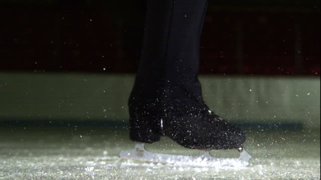 a figure skater spins on the ice. - figure skating stock videos & royalty-free footage
