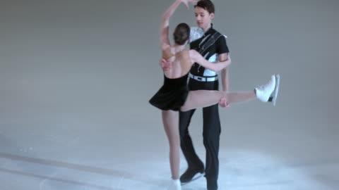 slo mo figure skating pair performing - figure skating stock videos & royalty-free footage