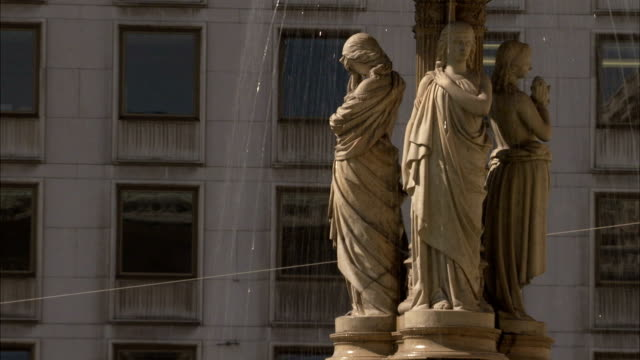 figures on a fountain outside the vienna state opera house represent seduction, sorrow, love and revenge. available in hd. - seduction stock videos & royalty-free footage