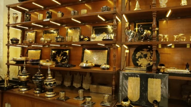 figurines and other items covered in gold leaf are displayed in a showroom at the king galon gold leaf workshop in mandalay, myanmar, on sunday, june... - gold leaf stock videos & royalty-free footage