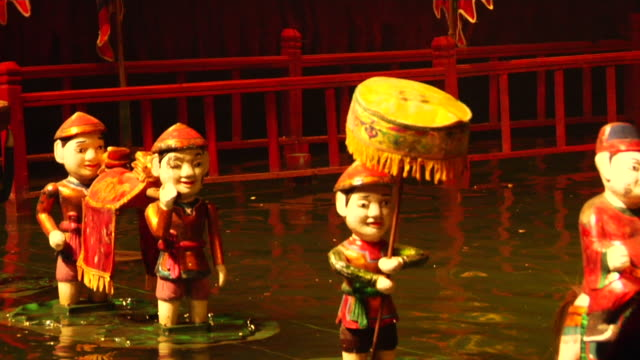CU Figurines floating on water, Long Water Puppet Theater show, Hanoi, Vietnam
