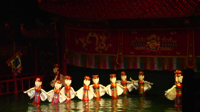 MS Figurines floating on water, Long Water Puppet Theater show, Hanoi, Vietnam