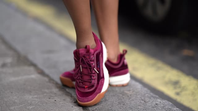 fila purple sneakers shoes are seen, during london fashion week september 2018 on september 14, 2018 in london, england. - sportschuh stock-videos und b-roll-filmmaterial