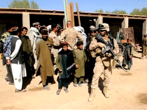file images show us general stanley mcchrystal, head of the nato-led force in afghanistan, during a visit to marjah in helmand province where... - helmand stock videos & royalty-free footage