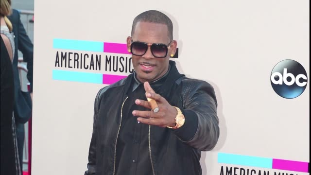 file photos of r&b star r. kelly as he is charged in chicago with 10 counts of aggravated criminal sex abuse some involving minors - r. kelly stock videos & royalty-free footage
