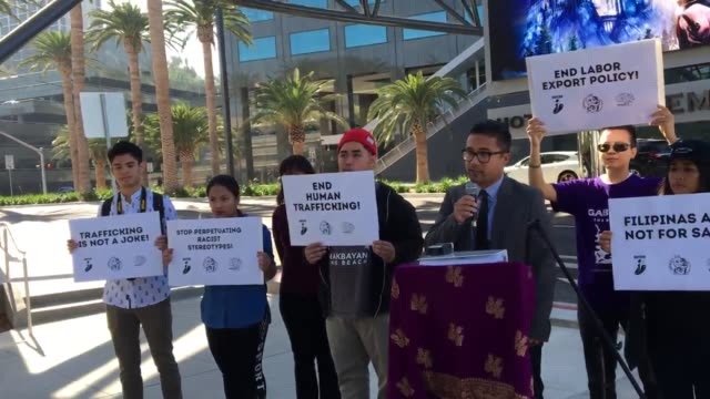 "filipino american activists picket outside of nbc universal to call for a meeting with studio executives over a proposed sitcom called ""mail order... - shirt and tie stock videos & royalty-free footage"